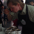 Alex from Muggswigz cupping coffee at Colombia coffee growing competition